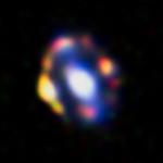 Астрономы случайно открыли рекордно далекую гравитационную линзу