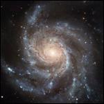 Галактика Вертушка темнее, чем мы думали